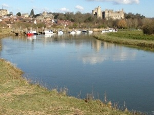 Arundel Castle reflected in the waters of the River Arun