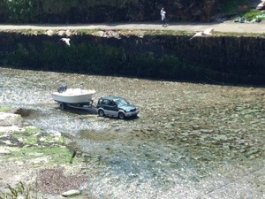 An interesting study. Why would one drive down a river towing a boat?