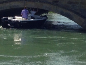boat under bridge in Arundel