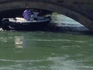 boat under bridge in Arundel