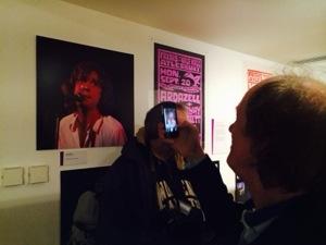 John Otway takes a picture of the John Otway exhibit